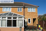 Two storey side extension with access to rear (rear external)